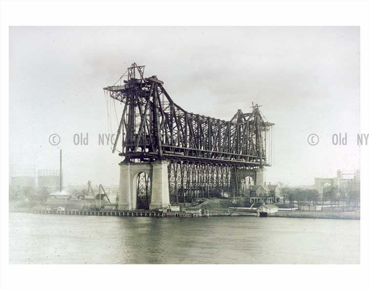 Roosevelt Island, formerly Blackwell Island with the Queensboro Bridge under construction