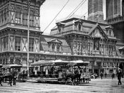 Scene at the Fulton Ferry, showing horse-drawn streetcars, c.1884