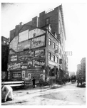 Side of a building covered in Ads - Bleecker Street Greenwich Village New York, NY 1900