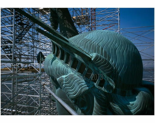 Statue of Liberty - left side of head in view - showing detail of crown