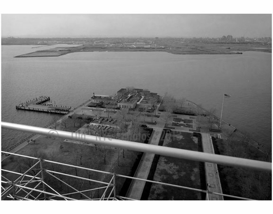 Statue of Liberty - view of scaffolding showing Liberty Island  landscpae & N.J. shoreline March 1985