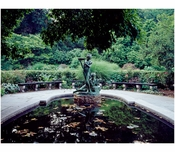 """Statue of Mary & Dickon from Frances Hodgson Burnett's """"The Secret Garden"""" at the reflecting pool of the conservatory Garden in Central Park"""