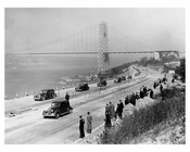 The opening of the westside highway with a clear shot of the  Triboro Bridge in the background 1937
