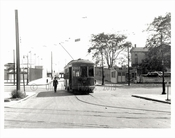 Trolley passing over Surf Ave