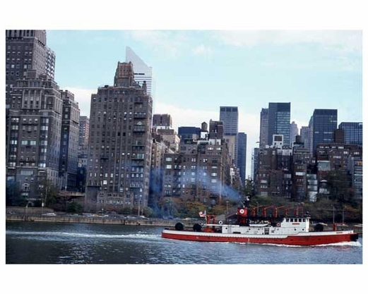 Tug boats going down the East River
