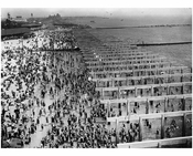 view of Coney Island beach while boardwalk is half constructed 1922