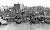 View of Williamsburg showing Gretsch Building, built 1916, from Williamsburg Bridge, 1935