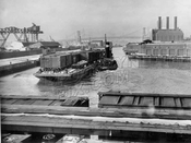 Wallabout Channel railroad car float being moved by tugboat, February 1941