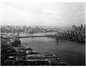 Williamsburg Bridge - overlooking the east river looking south towards Brooklyn on the left & Manhattan to the right