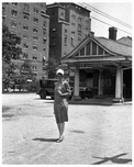 Woman in front of Kew Gardens LIRR Station 1928