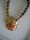 Patricia Healey's Copper Woman with Pierced Ears on Red Creek Jasper 12mm