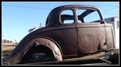1933 CHEVROLET COUPE BODY ON PIECE OF FRAME