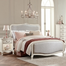 White Adalene Upholstered Bed