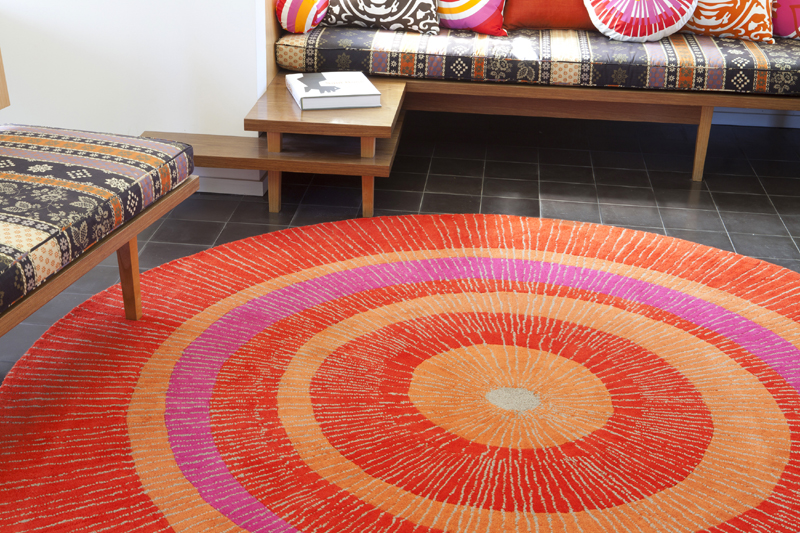 district eccentric large round rug in orange and red round, blue and orange round rug, burnt orange round rug, large orange round rug