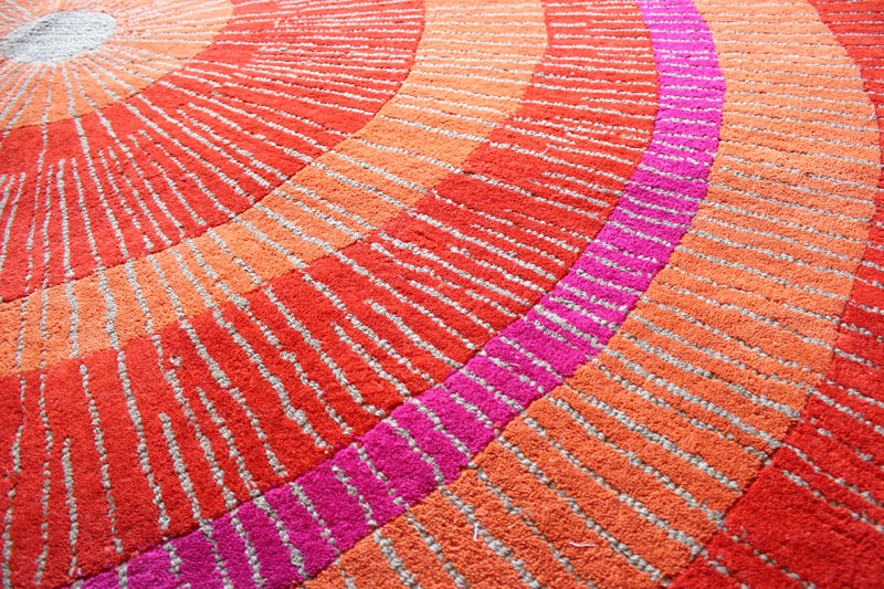 Eccentric Large Round Rug In Orange And Red