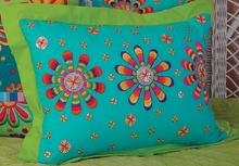 Turquoise Pillow with Three Flower Bursts