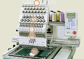 Tajima TEJT-II-C NEO Twelve Needle Embroidery Machine.