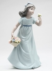 Breezy Spring Time Girl Porcelain Sculpture