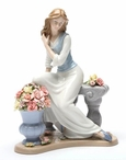 Elegant Serenade Woman Porcelain Sculpture