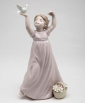 Girl Holding Dove Bird Porcelain Sculpture