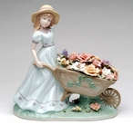 Girl Pushing Flower Cart Porcelain Sculpture