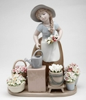 Girl with Flower Baskets Porcelain Sculpture
