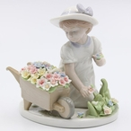 Girl with Flower Wagon Porcelain Sculpture by Nadal
