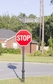 "Century Round Post Street Sign with Cast Blades and 24"" Stop Sign"