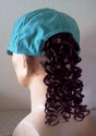Teal baseball cap with redish brown ponytail hair attached