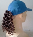 Blue baseball cap with redish brown ponytail hair attached