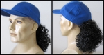 Blue Baseball cap with very curly ponytail