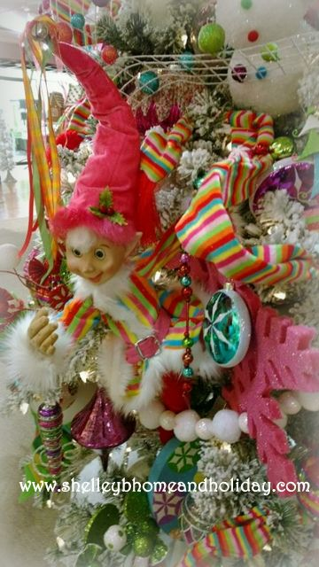 RAZ 30 inch Posable Christmas elf dressed in candy colored costume from the Candy Sprinkles collection