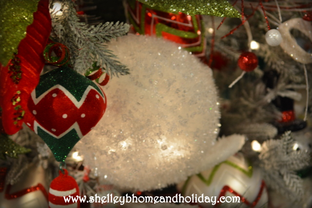 lighted snowball garland decoration in a Christmas tree
