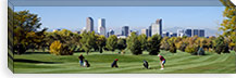 Four people playing golf with buildings in the background, Denver, Colorado, USA #PIM2704