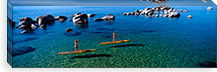Two women paddle boarding in a lake, Lake Tahoe, California, USA #PIM8846