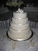 Four tier-stacked ivory wedding cake - by My Pink Apron