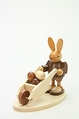 Easter Bunny Pushing Wheelbarrow Full Of Easter Eggs - Christian Ulbricht GmbH & Co