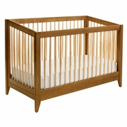 DaVinci Highland 4-in-1 Convertible Crib with Toddler Rail in Chestnut with Natural Spindles