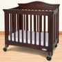 Foundations Royale Folding Fixed Side Compact Crib in Antique Cherry