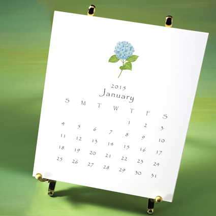 Garden calendar displayed on brass easel