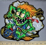 3816 G - Orange Haired Green Monster Riding Motorcycle - Back Patch - Embroidery Patch