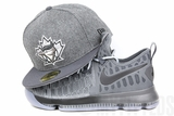 "Toronto Blue Jays Melton Wool Carbon Graphite Air Jordan XII ""Wool"" Matching New Era Hat"