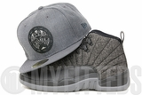 """Vancouver Grizzlies Carbon Graphite Heather Native Art Air Jordan XII """"Wool"""" New Era Fitted Hat"""