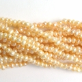 Freshwater Pearls Light Peach 4-5mm - 14 inch Strand