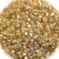 Seed Beads Hex Cut Transparant Silver-lined Topaz 11/0 Sold per pkg of 40 grams