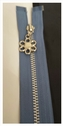 1 piece light  steal blue silver metal teeth with silver flower open end zipper 19 inch long.