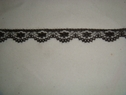 1 yard black narrow lace trim. 1/2 W L5-5