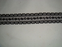 Black beautiful scalloped lace trim. 1 W L3-10