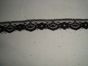 1 yard of black narrow lace  trim. 1/2 W L3-4