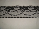 1 yard of black scalloped floral lace trim. 2 1/2 W. L3-8